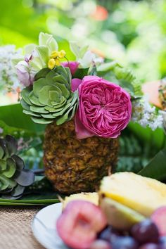 tropical wedding inspirational photo shoot - L&L Photography - pineapple and flower centerpiece
