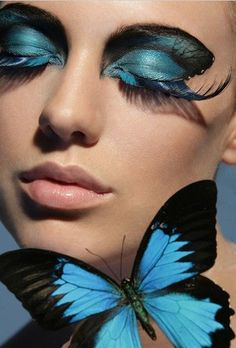 Blue butterfly makeup. I love how the eyelashes are inspired by expanding butterfly wings.
