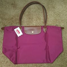 """LongChamp Le Pliage """"Shopping"""" modele Depose Embossed leather trims a durable, water resistant nylon tote that folds into a compact shape for travel and storage Top zip with snap-flap closure Interior wall pocket Folds flat for storage Nylon with leather trim By longchamp; imported $150 nordstrom tag, new Longchamp Other"""