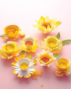 Create daffodil-shaped candy dishes for a fanciful table display using coffee filters and food coloring.