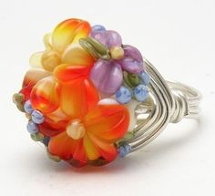Bridemaids gift ideas.  Brilynn can change the flower to match your wedding colors. Rich and Bright OrangeYellow Floral Lampwork Wire Wrap by Brilynn, $40.00