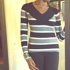 Striped Cute Sweater This v-neck sweater is very comfy, very stretchy. This cute sweater has black, white and gray in it. Love By Design Sweaters V-Necks