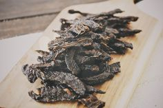 This paleo beef jerky recipe is full of flavor from several different spices including paprika, oregano, pepper, salt, and ground mustard. This beef jerky is easy to make and is way better for you than store packaged jerky.