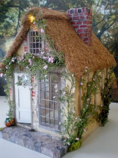Cinderella Moments: Marie Antoinette Cottage - Genius!  Coco Fiber Pot Liners for the Roofing