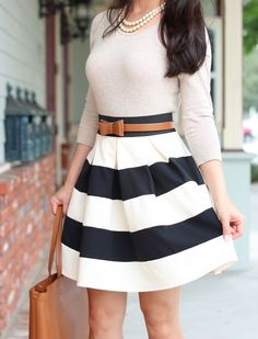 Classy--Love the outfit, the stripes and the colors! Pairing the Pantone Pink color or the year with a wide stripe skirt is perfection!
