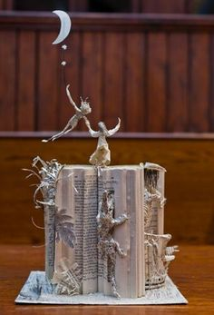 paper sculptures by Scotland's mystery artist go on show at the National Library of Scotland.