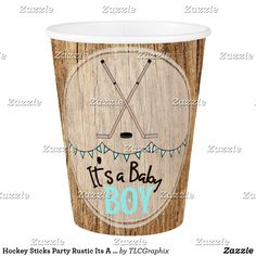 Hockey Sticks Party Rustic Its A Boy Baby Shower Paper Cup This product features crossed hockey sticks with a wood background. Great for a rustic, country hockey themed baby shower. #itsaboy #rustic #hockey #baby #shower