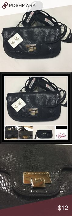 "◾️SOFIA VERGARA◾️ Stylish Black Clutch Sofia Vergara Very classy 11""x7"" black clutch with 7"" hand strap & nylon snakelike feel material. Silver tone hardware. Snap flaplike closure. 6"" zipper pocket inside. EUC few small scratches on nameplate, very light. See photos. Sofia Vergara Bags Clutches & Wristlets"