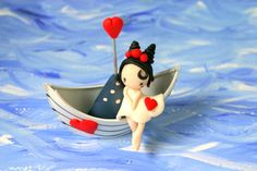 Hey, I found this really awesome Etsy listing at https://www.etsy.com/listing/449622770/figurine-on-boat