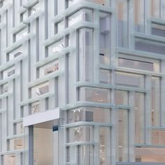 Rem Koolhaas' OMA completes a Tokyo store for Coach, comprising a glazed cube with a herringbone-patterned display system in Omotesando.