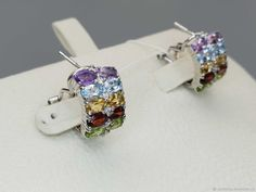 Materials: topaz, amethysts, citrines, chrysolites, garnets, cubic zirconia, silver Size: Length 17mm Metal: 925 sterling silver (the sample is worth) Inserts: 4 topaz oval 5x3 mm, 4 amethyst oval 5x3 mm, 4 citrine oval 5x3 mm, 4 chrysolite oval 5x3 mm, 4 garnet oval 5x3 mm, cubic zirconia Weight: 6.68 g. Lock: Italian ##handmade Topaz Earrings, Amethyst Earrings, Silver Earrings, Cubic Zirconia Earrings, Pomegranate, Sterling Silver, Metal, Handmade, Products