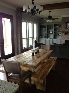 reclaimed wood dining table set with 2 matching benches.