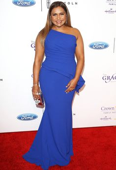 Mindy Kaling in a one-shoulder blue Elizabeth Kennedy dress
