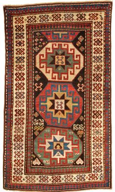 A superb Kazak rug with a single vertical row of 'Memlinc guls'. Great condition, even wear with good pile to the borders and lower pile to the middle. 2nd half 19th century. Superb colour and typical Kazak weave. | eBay!