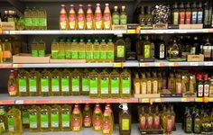 which oils are the best to cook with Assorted oil on a supermarket shelf
