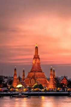 Watch the gorgeous sunset at Wat Arun in Bangkok, Thailand.