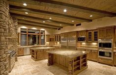Travertine Tile Kitchen Floor with Stone Walls. Probably wouldn't have this but it looks amazing