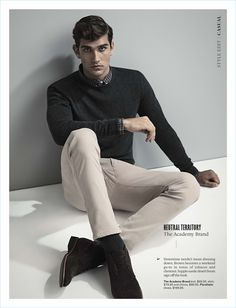 Embracing smart style, Jack Vanderhart wears a sweater, shirt, and chinos by The Academy Brand with Florsheim shoes.