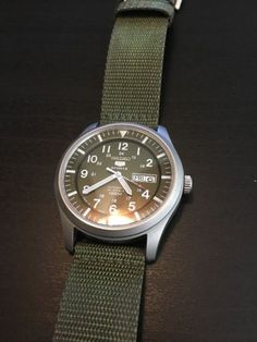 Seiko Men's 5 Sports Automatic Green Dial Day Date Canvas Band Watch SNZG09J1
