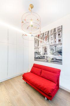 Red sofa on grey flooring.