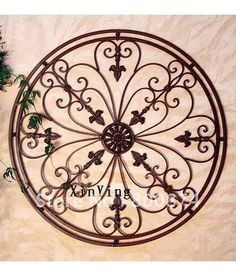 Wrought iron wall art for Tuscan kitchen