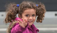 15 Triumphant Photos Show Thousands of Refugees Being Welcomed Into Germany