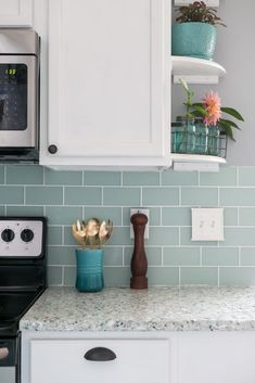 I can't believe that this coastal kitchen was a complete DIY! Love the beautiful terrazzo recycled sea glass and oyster shell counter tops Mint green kitchen island, white cabinets, sea glass backsplash- Charleston Crafted Mint Green Kitchen, Green Kitchen Island, Glass Tile Backsplash, Kitchen Backsplash, Kitchen Cabinets, Backsplash Ideas, Kitchen Shelves, Cupboard Shelves, Corner Shelves