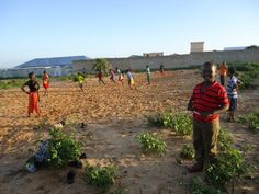 In Mogadishu, Somalia, children have decided to take their soccer games into their own hands - by making their own field!