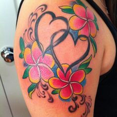 I finally found THE ONE!!!!  2 hearts representing V & I, and 2 plumerias (my favorite flower) representing the boys (colors for their birth month) YAY  Timeless Tatoo-Menifee