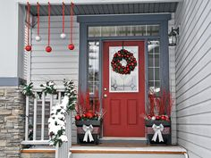 Choose two main colors to work with for your holiday decor. The colors should complement your house's exterior paint, wood, or stone work. Tie it all together by repeating elements like garland or red and white Christmas balls.