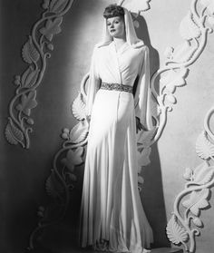 Lucille Ball in a super elegant hooded 40s gown.