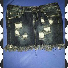 Skirt Distressed jean skirt.  (Stretch)75%Cotton, 23%Polyester,  2%Spandex. Super cute :) Rue 21 Skirts Mini