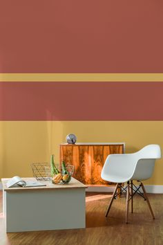 Bring warmth into your home with this striped wallpaper design. Golden tones of yellow mix with a fiery red, giving your interiors a stylish yet balanced space. Perfect for living room settings.