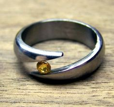 Contemplating bling. Titanium Ring with Yellow Sapphire tension set by RobandLean, $165.00