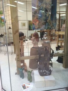 """Harlequin sculpture by Lyndsey Hatchwell, 2 wonderful bronze torsos by Paul Hattaway and his painting """"Cranium Policy"""" in our other window."""