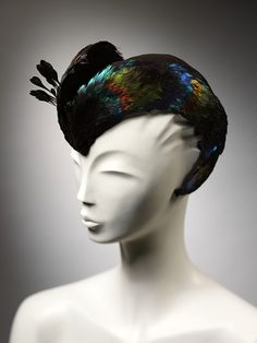 A dramatic Caroline Reboux hat from 1946.  I just love this one!  The sheen and the colors are fabulous.