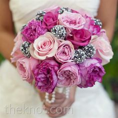 For a truly unique touch, silver-painted scabiosa pods punched up Teresa's bouquet of pink roses.