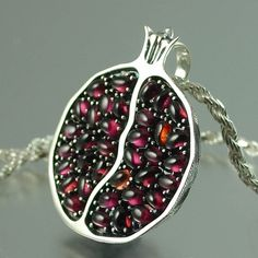 Silver Pomegranate pendant! Beautiful use of cabochon garnets.  [i looooove this]
