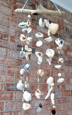 Make shell wind chimes with shells, driftwood and other decorative items added on.