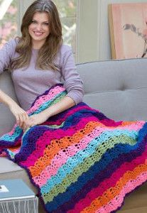 The Rainbow Bright Stripe Throw is the perfect shell stitch pattern for summer. It's a free crochet afghan pattern you don't want to miss out on!