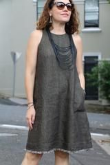 Bondi Dress -this sleeveless dress features a high neckline, cut away armholes, bust d...