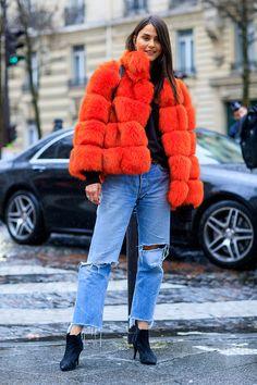 Paris Fashion Week Street Style: Red furry coat, distressed denim and ankle boots