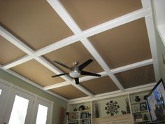 Hubby got this idea from a magazine, panels and beams of mdf cover ugly yellow semi-gloss popcorn ceiling