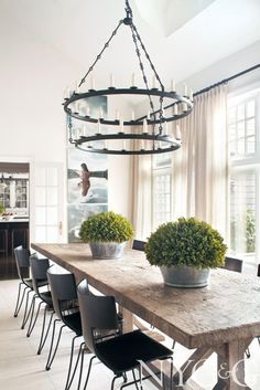 Long Island Retreat Designer: Mark Epstein Antique Belgian oak trestle table paired with modern classic Klismos chairs by Donghia