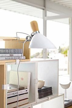 """How To Make A Teeny-Tiny Home Feel Palatial #refinery29  http://www.refinery29.com/living-archive-135#slide-9  """"Good lighting in small spaces can add balance and brightness, so definitely consider your lighting design. This clip lamp is a cool and efficient take on the table lamp."""" Design Within Reach Pearson Clip Lamp, $265, available at Design Within Reach...."""