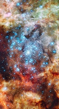 A Hubble Space Telescope image of the R136 super star cluster, near the center of the 30 Doradus Nebula, also known as the Tarantula Nebula or NGC 2070.