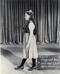 """Judy Garland in a wardrobe/makeup test for """"The Wizard of Oz"""" 1939    Notice the unused set of ruby slippers.."""