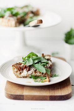 Mushroom tart with black olives goat cheese camembert walnuts & rucola.