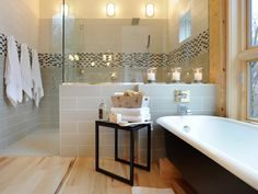 This large shower lends a spa-like feel to the master bath. A mosaic tile pattern adds color to the otherwise neutral room.