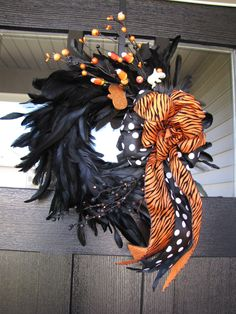 """Sassy Black and Orange Halloween Feather Wreath. Love the ribbons & """"candy corn"""" pics!"""